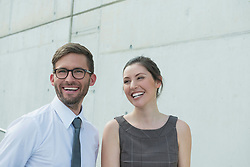 portrait of two business partners smiling