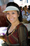 Attractive happy Hmong woman working in outdoor restaurant. Hmong Sports Festival McMurray Field St Paul Minnesota USA