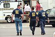 ATF investigators walk past the US Capitol after a shooting erupted on Capitol Hill July 24, 1998 in Washington, DC. Two US Capitol police officers were killed in the incident, one person wounded and the lone gunmen was wounded and taken into custody.