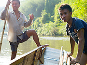 Boatmen Sengkham and Savath take a rest after pulling the boat up the rapids on the Nam Ou river during the dry season when the river level is low, Phongsaly province, Lao PDR. The Nam Ou river connects small riverside villages and provides the rural population with food for fishing. But this river and others like it, that are the lifeline of rural communities and local economies are being blocked, diverted and decimated by dams. The Lao government hopes to transform the country into 'the battery of Southeast Asia' by exporting the power to Thailand and Vietnam.