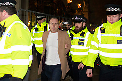 © Licensed to London News Pictures. 03/12/2019. London, UK. Right wing activist Danny Tommo is removed from an Anti Trump demonstration outside Buckingham Palace by police. Photo credit: George Cracknell Wright/LNP