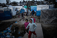 Children playing in the camp. About 20000 are living in a makeshift camp nearby the city of Moria on the island of Lesbos in miserable conditions, most of the without water, electricity nor sanitary facilities.  Federico Scoppa