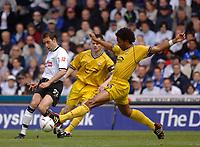 Fotball<br /> England 2004/2005<br /> Foto: SBI/Digitalsport<br /> NORWAY ONLY<br /> <br /> Derby County v Preston North End.<br /> Coca Cola Championship. 08/05/2005<br /> <br /> Derby's Marco Reich (L) is tackled by Preston's Youl Mawene
