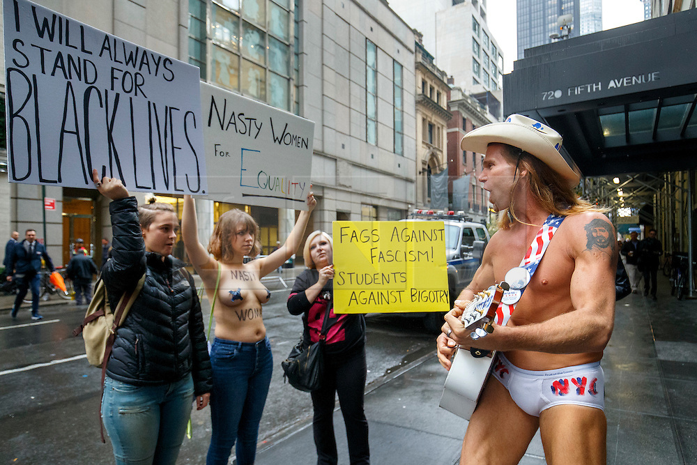 © Licensed to London News Pictures. 09/11/2016. New York CIty, USA. New York's naked cowboy, who is also a pro-Trump supporter celebrates as anti-Trump campaigners protest outside Trump Tower in New York City, on Wednesday, 9 November 2016 following the presidential election won by Donald Trump. Photo credit: Tolga Akmen/LNP