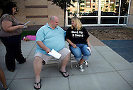 """Brian Albano (C) and wife Becky (R) wait in line for an open casting call for season 11 of """"The Biggest Loser"""" television show in Broomfield, Colorado July 17, 2010. The couple was waiting for a chance to be on the show and win $250,000.  Over 600 people attended the casting call.   REUTERS/Rick Wilking (UNITED STATES)"""