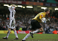 Photo: Lee Earle.<br /> Barnsley v Swansea City. Coca Cola League 1. Play off Final. 27/05/2006. Barnsley keeper Nick Colgan (R) wheels away in delight after saving Alan Tate's (L) penalty.