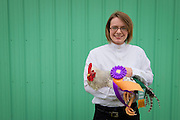4-H girl and her champion rooster. Clallam Co. (WA) Fair.