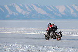 Sergey Batyrin racing his Ural that was modified to be in-line with a snowmobile transmission and pull-start in the Baikal Mile Ice Speed Festival. Maksimiha, Siberia, Russia. Friday, February 28, 2020. Photography ©2020 Michael Lichter.
