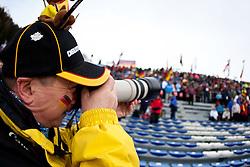 21.01.2011, Südtirol Arena, Antholz, ITA, IBU Biathlon Worldcup, Antholz, Sprint Women, im Bild Feature, ein Zuschauer aus Deutschland und deutscher Biathlon Fan fotografiert in die Zuschauermenge // Feature, a spectator from Germany and German biathlon fan photographed in the crowd during IBU Biathlon World Cup in Antholz, Italy, EXPA Pictures © 2011, PhotoCredit: EXPA/ J. Feichter