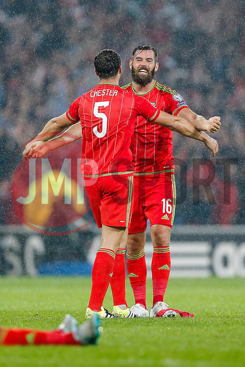 James Chester (Hull City) and Joe Ledley (Crystal Palace) celebrate after Wales win the match 1-0 to top their UEFA2016 Qualifying Group - Photo mandatory by-line: Rogan Thomson/JMP - 07966 386802 - 12/06/2015 - SPORT - FOOTBALL - Cardiff, Wales - Cardiff City Stadium - Wales v Belgium - EURO 2016 Qualifier.