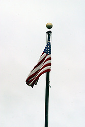 10 June 2006  American Flag flying against grey cloud background