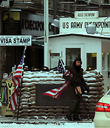 Checkpoint Charlie. Checkpoint Charlie was the name given by the Western Allies to the best-known Berlin Wall crossing point between East and West Berlin during the Cold War. This image shows the crossing post after re-unification.