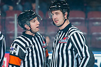 KELOWNA, BC - JANUARY 3: Referee Trevor Nolan stands on the ice speaking to line official Brett Mackey at the Kelowna Rockets against the Victoria Royals at Prospera Place on January 3, 2020 in Kelowna, Canada. (Photo by Marissa Baecker/Shoot the Breeze)
