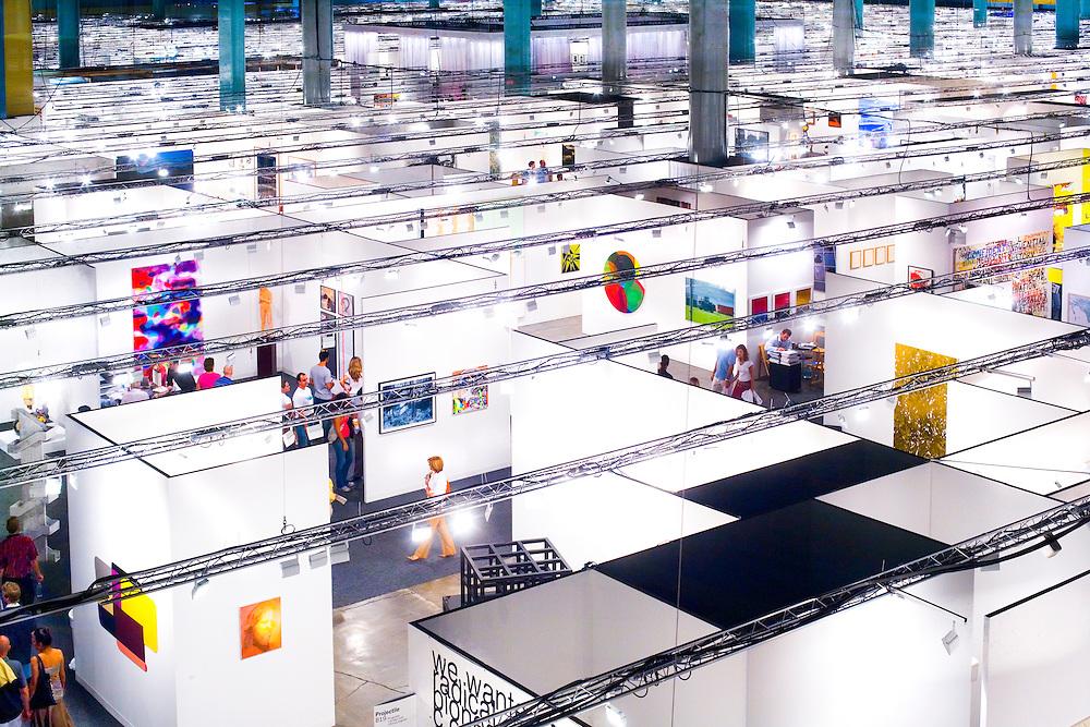 Aerial view of people browsing the enormous Art Basel Miami Beach art fair