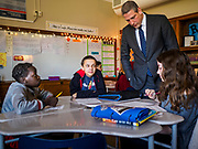 """08 APRIL 2019 - DES MOINES, IOWA: Rep. TIM RYAN talks to 7th grade students during a classroom visit at Callanan Middle School. Ryan, a candidate for the Democratic ticket of the US presidency, visited Callanan Middle School in Des Moines to discuss education issues. Ryan declared his candidacy on the US television show """"The View"""" on April 4. Ryan, 45 years old, represents Ohio's 13th District, which includes Lordstown, where a large General Motors plant recently closed. He is the latest Democrat to announce his candidacy to be the Democratic nominee in the 2020 election. Iowa holds its presidential caucuses on Feb. 3, 2020.     PHOTO BY JACK KURTZ"""