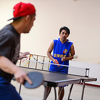 021415       Cable Hoover<br /> <br /> Ron Casilac, center, faces off with Dennis Poquita in a table tennis match at the Palarong Pinoy Filipino Sportsfest Saturday at the NTU arena in Crownpoint. The event featured competitions in table tennis, volleyball, basketball, badminton and chess for Filipino community members throughout the region.