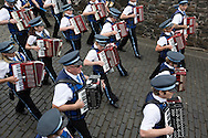 A traditional Scottish accordion band marching during Pipefest Stirling, an event staged at Stirling Castle to coincide with the 700th anniversary of the Battle of Bannockburn. The event was attended by 1600 pipers, Highland dancers and other musicians and formed a procession through the city's streets. The Battle of Bannockburn took place in 1314 and resulted in the defeat of Edward II's English army by the Scots under Bruce.