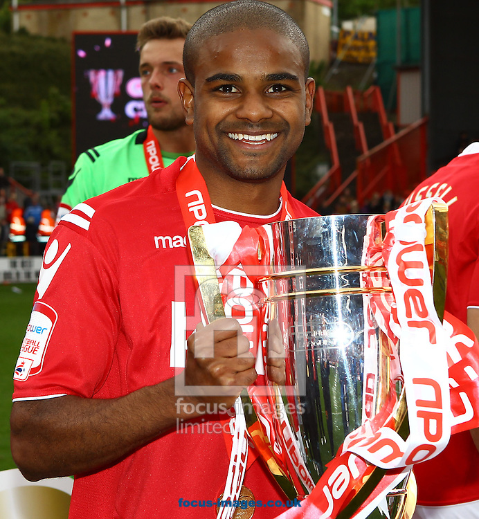 Picture by John Rainford/Focus Images Ltd. 07506 538356.05/05/12.Bradley Pritchard of Charlton Athletic with the Npower League 1 trophy at The Valley stadium, London.