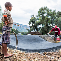 A boy looks on as the Roma pump track takes shape, Lesotho.