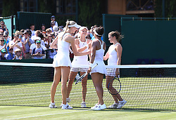 Heather Watson (second right) and Naomi Broady (left) shake hands with Harriet Dart (second left) and Katy Dunne after their match against on day four of the Wimbledon Championships at The All England Lawn Tennis and Croquet Club, Wimbledon.