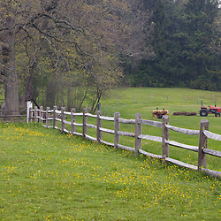 A split rail fence and tractor  in Ipswich Massachusetts USA