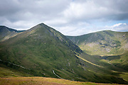 Catstye Cam summit and the surrounding valley, west of Helvellyn mountain, The Lake District, Cumbria, United Kingdom on the 2nd of August 2021. Catstye Cam is connected to Helvellyn by Swirral Edge, one of the famous walking routes in the Lake District.