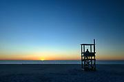 Person watches the sunrise over the ocean, Nauset Beach, Cape Cod National Seashore, Cape Cod, Massachusetts, USA