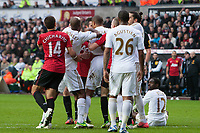 Football - 2012 / 2013 Premier League - Swansea vs. Manchester United<br /> Robin van Persie of Manchester United and Swansea's Ashley Williams square up following a challenge at the Liberty Stadium