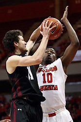 25 February 2015:  Tyler Smithpeters looks for a shot while guarded by John Jones  during an NCAA MVC (Missouri Valley Conference) men's basketball game between the Southern Illinois Salukis and the Illinois State Redbirds at Redbird Arena in Normal Illinois