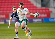 London Irish Fullback James Stokes passes the ball during a Gallagher Premiership Round 14 Rugby Union match, Sunday, Mar 21, 2021, in Eccles, United Kingdom. (Steve Flynn/Image of Sport)