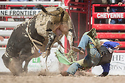 Bull rider Zack Oakes of Tonasket, Washington is thrown from Donosdo at the Cheyenne Frontier Days rodeo at Frontier Park Arena July 24, 2015 in Cheyenne, Wyoming. Frontier Days celebrates the cowboy traditions of the west with a rodeo, parade and fair.