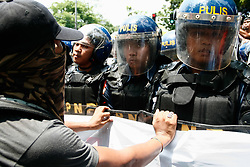 April 29, 2017 - Philippines - Protesters from different groups converged along Quirino Avenue in Manila, Saturday morning, as they try to air their sentiments during the ASEAN summit at the PICC. Platoons of police in full riot gear blocked the march along Adriatico street in Manila. (Credit Image: © J Gerard Seguia via ZUMA Wire)