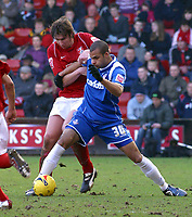 Photo: Dave Linney.<br />Walsall v Oldham Athletic. Coca Cola League 1. 18/02/2006 Walsall's (L) keeps a close eye on  Chris Hall