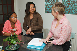 Professional interviewing mother and daughter.