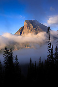 Fog rises up around Heavy Runner Mountain, Glacier National Park.