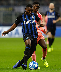 November 7, 2018 - Milan, Italy - Kwadwo Asamoah (L)  of Inter Milan and Ousmane Dembele of Barcelona vie for the ball during the Group B match of the UEFA Champions League between FC Internazionale and FC Barcelona on November 6, 2018 at San Siro Stadium in Milan, Italy. (Credit Image: © Mike Kireev/NurPhoto via ZUMA Press)