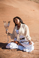 """Sacred woman in yoga lotus pose.<br /> :::<br /> """"When you rise in the morning, give thanks for the light, for your life, for your strength. Give thanks for your food and for the joy of living. If you see no reason to give thanks, the fault lies in yourself.""""<br /> -Tecumseh Native American Navajo Woman Yogini. Diné woman practicing yoga in her indigenous red earth environment."""