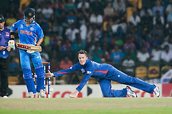 © Licensed to London News Pictures. 23/09/2012. Graeme Swann of England dives to try and stop the ball during the T20 Cricket World T20 match between England Vs India at the R.Premadasa Cricket Stadium,Colombo. Photo credit : Asanka Brendon Ratnayake/LNP