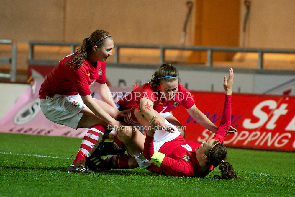 LLANELLI, WALES - Thursday, March 31, 2011: Wales' captain Nia Jones celebrates with team-mates Megan Wynne and Jasmin Dutton after scoring the equalising goal to claim a 1-1 darw against Germany during the UEFA European Women's Under-19 Championship Second Qualifying Round (Group 3) match at Parc Y Scarlets. (Photo by David Rawcliffe/Propaganda)