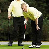 13 September 2007; Liam O'Connor and his playing partner Noel Dinan, left, Woodstock G.C., Ennis, Clare, line up a putt on the 12th during the Bulmers Pierce Purcell Shield Semi-Finals. Bulmers Cups and Shields Finals 2007, Shandon Park Golf Club, Belfast, Co. Antrim. Picture credit: Ray McManus / SPORTSFILE