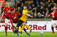 Wolverhampton Wanderers midfielder Joao Moutinho (28) battles with Manchester United Midfielder Jesse Lingard during the The FA Cup match between Wolverhampton Wanderers and Manchester United at Molineux, Wolverhampton, England on 16 March 2019.