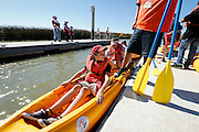 Vince Maguire and his daughter Grace, foreground, of San Jose load into a kayak before embarking on an adventure through the marshlands during Santa Clara County Parks Day on the Bay event at Alviso Marina County Park in Alviso, California, on October 13, 2013. (Stan Olszewski/SOSKIphoto)
