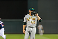 Oakland Athletics pitcher A.J. Griffin reacts after giving up a home run to Minnesota Twins left fielder Josh Willingham (not shown) on July 13, 2012 at Target Field in Minneapolis, Minnesota.  The Athletics defeated the Twins 6 to 3.  © 2012 Ben Krause