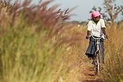 Abdulai Sadia rides a bicycle through the community of Kunayili, near Gushegu, Northern Ghana, on Wednesday November 2, 2011.