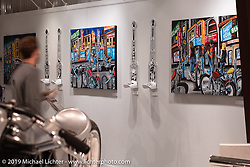 Tattoo and Motorcycle artist Darren McKeag's paintings on display in the What's the Skinny Exhibition (2019 iteration of the Motorcycles as Art annual series) at the Sturgis Buffalo Chip during the Sturgis Black Hills Motorcycle Rally. SD, USA. Friday, August 9, 2019. Photography ©2019 Michael Lichter.