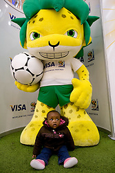 Zakumi official mascot of FIFA World Cup and a kid at Nelson Mandela Square shopping centre in Sandton on June 12, 2010 in Johannesburg, South Africa.  (Photo by Vid Ponikvar / Sportida)