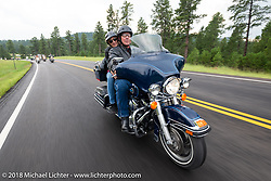 Dave Wilson of Sturgis Real Estate on the Legends Ride - riding from Deadwood to the Buffalo Chip during the 78th annual Sturgis Motorcycle Rally. Sturgis, SD. USA. Monday August 6, 2018. Photography ©2018 Michael Lichter.