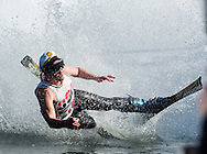 A skier falls while crossing the water during the Wacky Water Event at the Spring  Rally at Mount Peter Ski and Ride in Warwick, New York. The Spring Rally traditionally closes the season at the ski area.