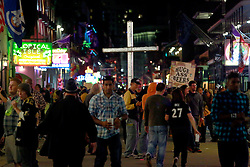 03 Feb 2013. New Orleans, Louisiana USA. .Bourbon Street. 'Huge Ass' beer sellers compete for attention as preachers take to the street to try and persuade people that they are living in sin and need to change their ways. .Photo; Charlie Varley