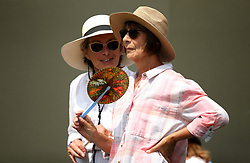 Spectators on day seven of the Wimbledon Championships at the All England Lawn Tennis and Croquet Club, Wimbledon. PRESS ASSOCIATION Photo. Picture date: Monday July 9, 2018. See PA story TENNIS Wimbledon. Photo credit should read: Steven Paston/PA Wire. RESTRICTIONS: Editorial use only. No commercial use without prior written consent of the AELTC. Still image use only - no moving images to emulate broadcast. No superimposing or removal of sponsor/ad logos. Call +44 (0)1158 447447 for further information.